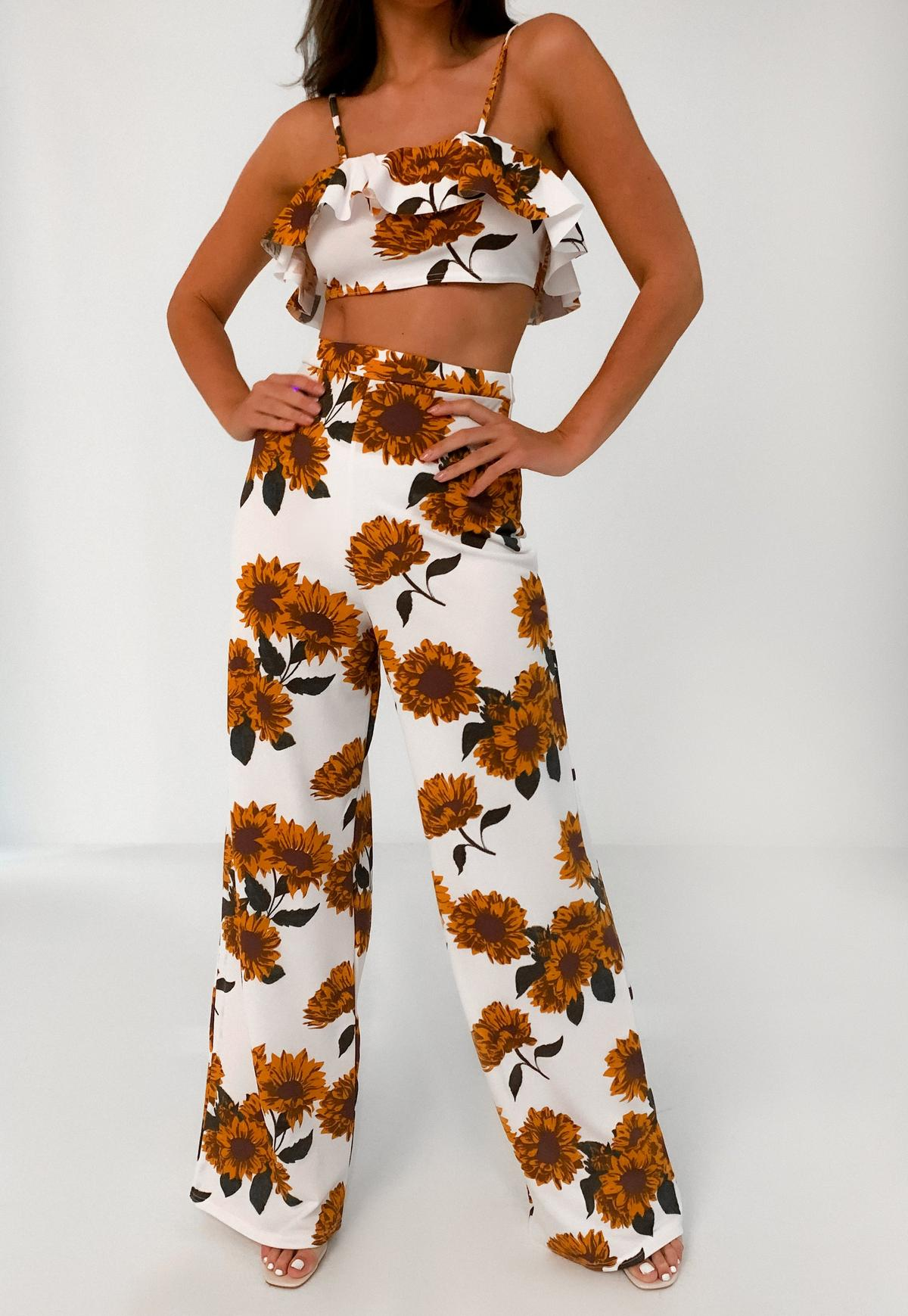 white floral ruffle top and wide leg trousers co ord set