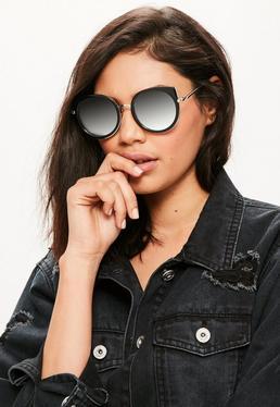 Sonnenbrille mit gerundetem Katzenaugen Gestell in Schwarz
