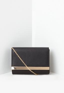 Czarna kopertówka z ozdobną metalową wstawką
