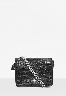 Schwarze Handtasche im Kroko Stil