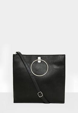 Schwarze Handtasche mit rundem Metall Detail