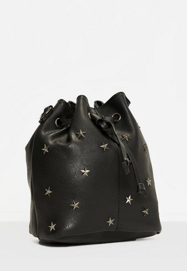 95214efb11 Star Studded bucket bag with guitar strap