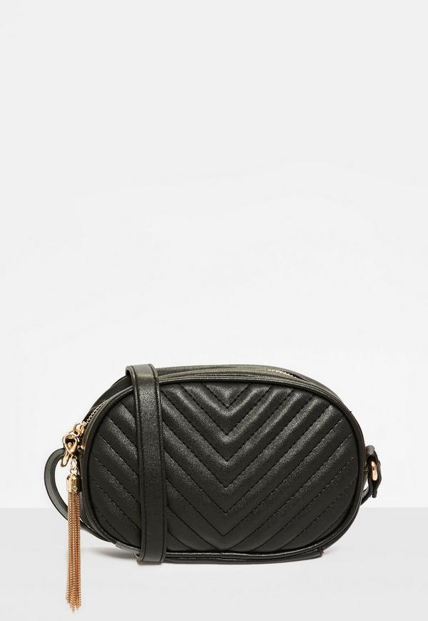 black quilted cross body bag with tassel trim