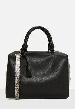 Schwarze Handtasche mit Schlangenmuster-Träger