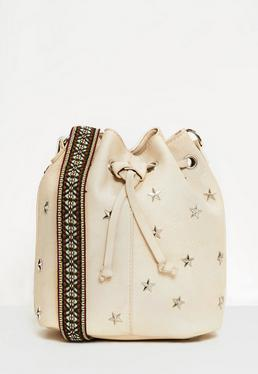 Beżowa torba worek z ozdobnymi gwiazdkami