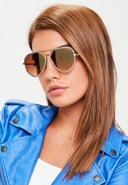 Złote wycięte okulary przeciwsłoneczne w geometrycznych oprawkach