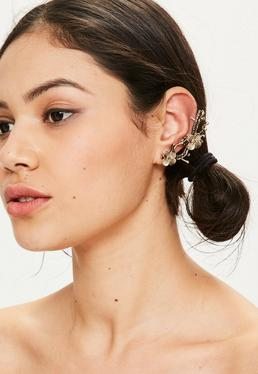 Bijou d'oreille doré à fleurs