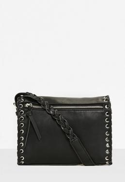 Bolso cruzado con puntadas entrecruzadas en negro