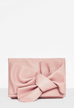 Bolso clutch con lazo en rosa