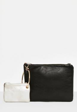 Czarna torebka połączona metalowym kółkiem z mini kopertówką