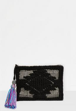 Bolso de mano bordado con borlas en negro