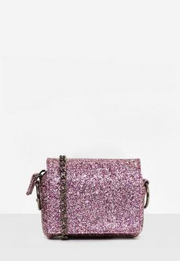 Bolso bandolera con purpurina y cadena metálica en rosa