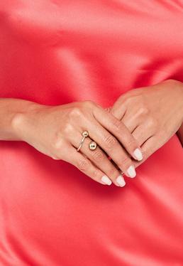 Ring mit Piercing-Besatz in Gold