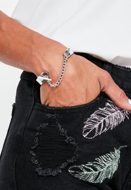 Brazalete rígido con cierre por cadena en plata