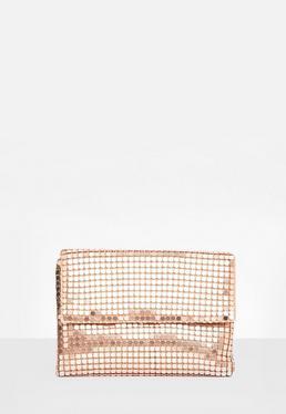 Torebka kopertówka w kolorze różowego złota