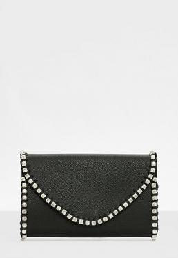 Pochette noire à bordure strass
