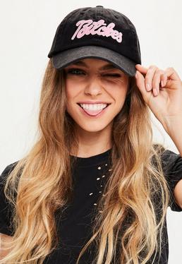 Gorra con eslogan en negro
