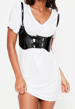 Cinturón con arnés de charol en negro