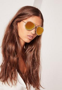 Złote okulary przeciwsłoneczne w geometrycznych oprawkach