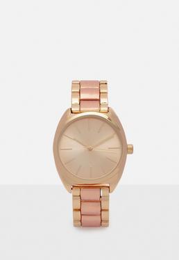 Reloj de pulsera con correa metálica en dos dorados