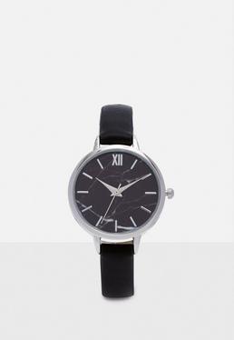 Czarny analogowy zegarek z metalową tarczą