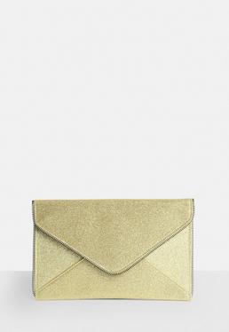Złota torebka kopertówka