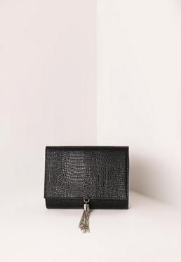 Pochette noire en faux croco avec pompon chaînes