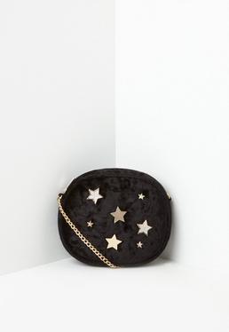 Czarna welurowa torebka na łańcuszku w gwiazki