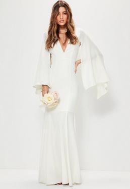 Vestido largo de novia con escote en v manga estilo capa en blanco
