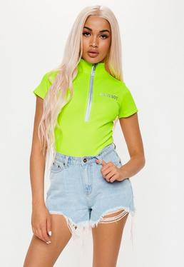f1676ade2dc Playboy X Missguided Lime Slogan Zip Front Ribbed Bodysuit
