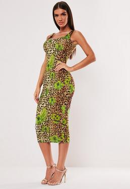 e3c23d54ca4 ... Vestido midi de leopardo con mariposas en marrón