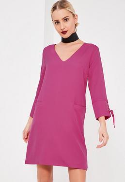 Różowa sukienka z wiązaniami na rękawach