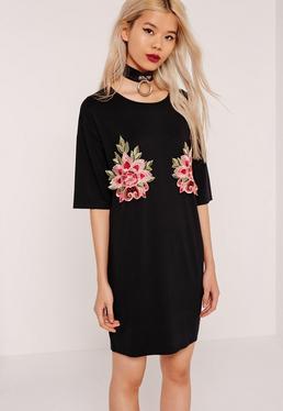 T-Shirt-Kleid mit Applikationen in Schwarz