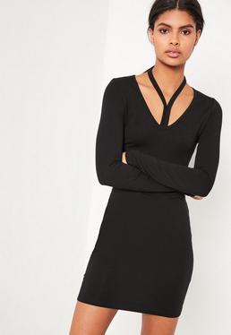 Robe moulante noire effet harnais à manches longues