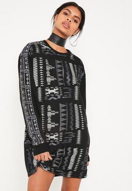 Pulloverkleid mit Aztekenstickereien in Schwarz