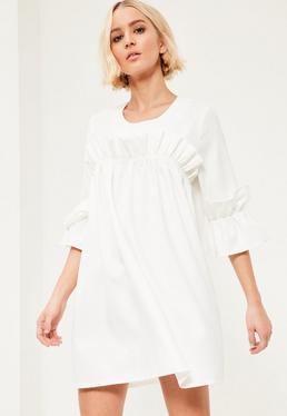 Biała luźna sukienka z falbankami
