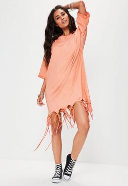 Vestido oversize de efecto lavado con flecos en el bajo en naranja