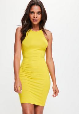 Żółta dopasowana elastyczna sukienka na ramiączkach