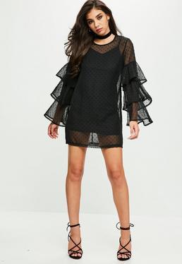 Vestido recto plumeti con transparencias en negro