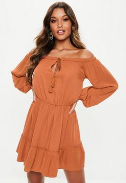 336ab5a7aee Rust Bardot Tassel Skater Dress