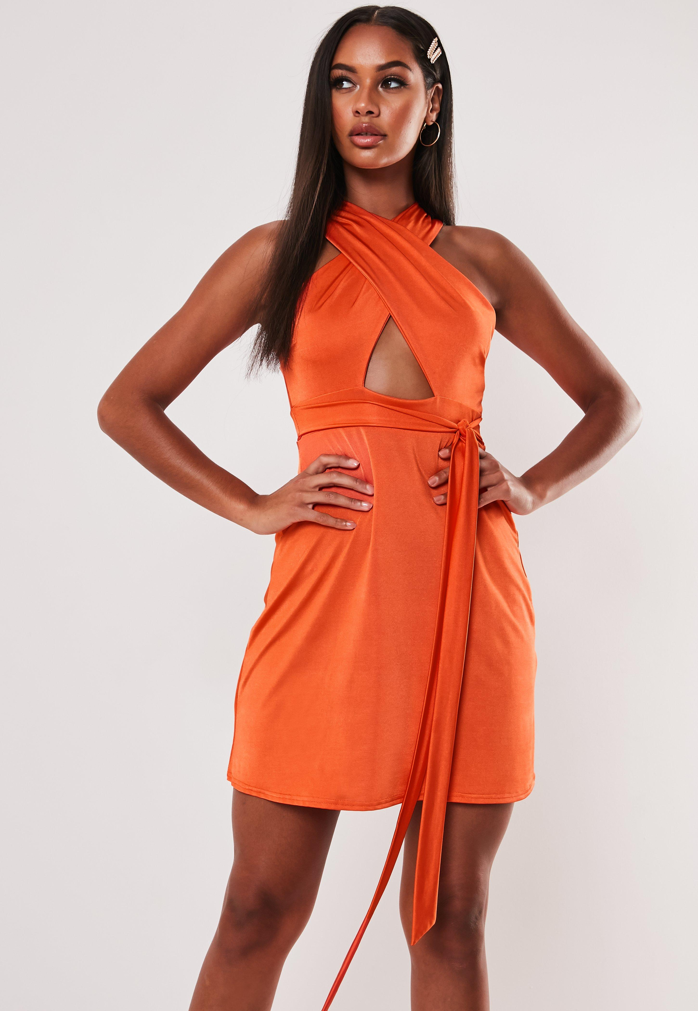 5fa14b20a4d03 Orange Slinky Wrap Front Skater Dress