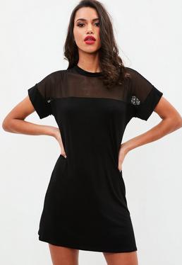 Черное платье с сетчатой футболкой