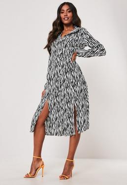 4177bb17400 White Poplin Sleeveless Shirt Dress · White Zebra Print Midi Shirt Dress