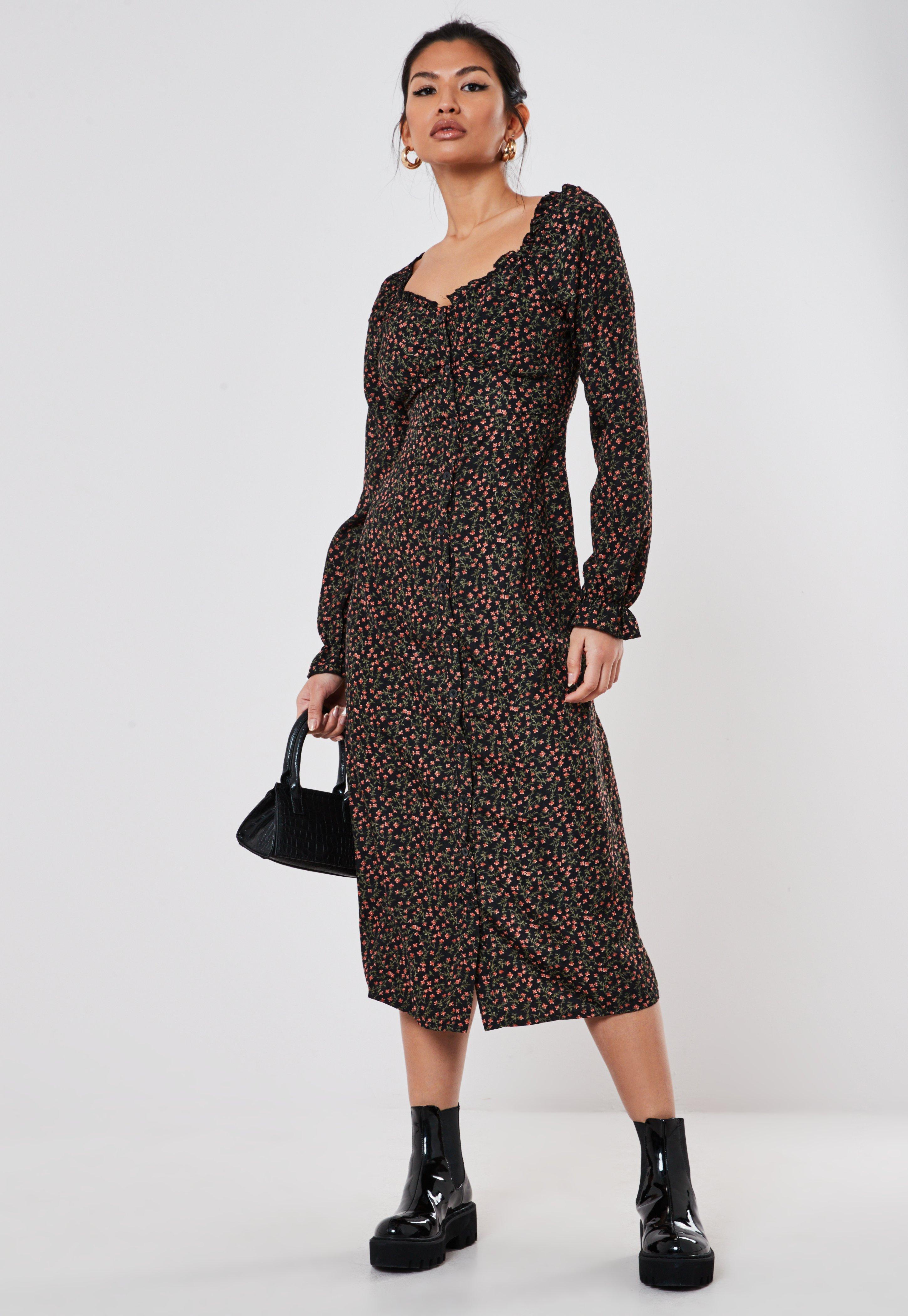 Czarna sukienka midi z dekoltem milkmaid i kwiatowym wzorem
