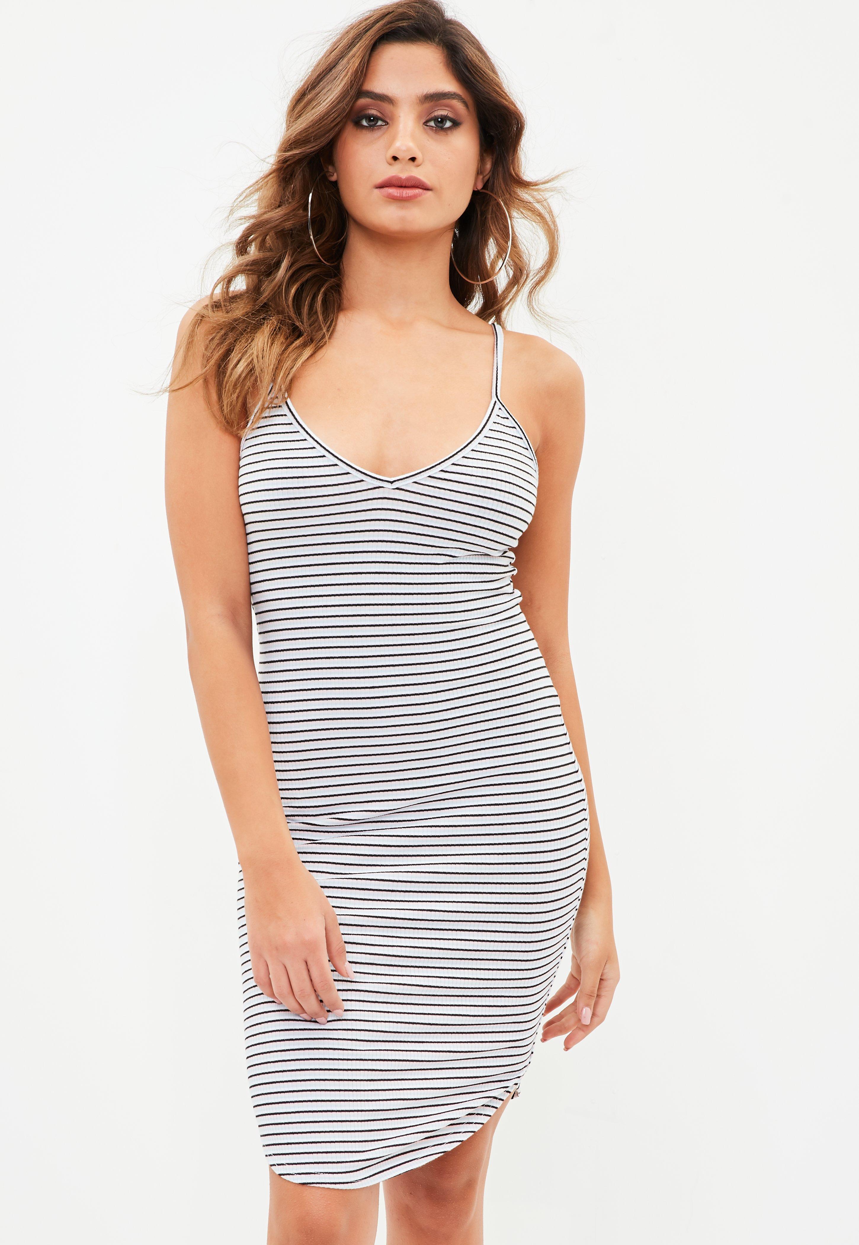 White mini dress with silver cage strap back