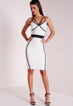 Monochromowa dopasowana sukienka bandażowa z modnymi paskami