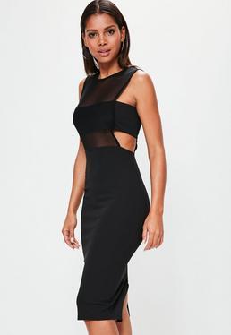 Czarna sukienka bez rękawów z wycięciami i dodatkiem siatki