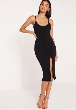 Czarna sukienka za kolano na ramiączka z rozporkiem na boku