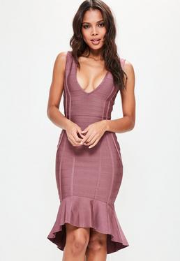 Fioletowa bandazowa sukienka midi z głebokim dekoltem zakończona falbanką
