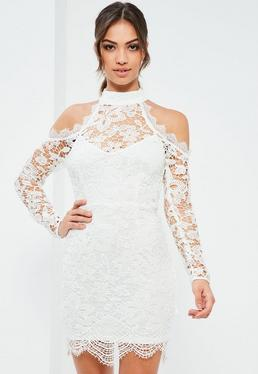 Biała koronkowa dopasowana sukienka z wyciętymi ramionami